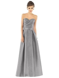 Rich Dupioni defines the A-line silhouette of Dessy Alfred Sung D537 bridesmaid dress, divided at the natural waist with a matching belt. Asymmetrical pleating adorns the surplice bodice, following the contours of the strapless sweetheart neckline. Beneath, the box-pleated skirt billows toward the floor with side pockets. Set includes optional spaghetti straps.