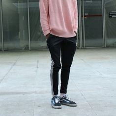 Baggy coral/ pink sweater Adidas track pants (end half way up the shin)