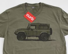 Land Rover Defender 90 T-shirt by with art by Stuart Macey. Inspired by the Willys the Land Rover was first developed by chief designer Maurice Wilks as a farm work truck in Wales in 1947. The Land Rover Ninety and One Ten were sold virtually unchanged from 1983 until 2015. Printed in California on premium quality 100% cotton T-Shirts.  Click here for sizing info.