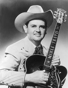 """Merle Travis (b. November October Native of Rosewood, Muhlenberg County, Kentucky. Developer of a Kentucky guitar picking style known as """"thumb picking."""" Inducted into the Country Music Hall of Fame in Old Country Music, Country Music Artists, Country Music Stars, Country Singers, Country Musicians, Jim Glaser, Travis Songs, Rock And Roll, Ricky Van Shelton"""