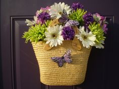 An alternative to a wreath...a basket of flowers. I made this following a similar pin that uses a straw purse.