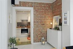 Ryan lives in a small but organized apartment. He has an exposed brick wall