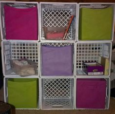 DIY fabric bin storage. Just use milk crates (not the ones you buy at wal mart but the actual 4 gallon milk crates). Tie together with zip ties and if you wish you can spray paint or wrap in fabric for decoration. The fabric bins fit perfectly in them.