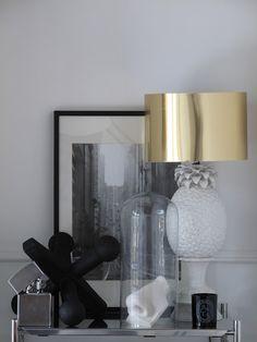 Love the shiny gold lamp shade.