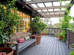 The tranquil two-story home is surrounded by pergola-covered decks and patios. The tranquil two-stor Pergola Shade, Pergola Patio, Pergola Kits, Backyard Landscaping, Pergola Cover, Backyard Ideas, Pergola Ideas, Covered Decks, Covered Pergola