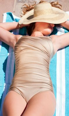 Loving this gold vintage bathing suit.