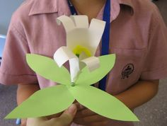 Easter Lily ~ This is a simple craft of the traditional Easter flower, the lily, that I did with my class at school . I started by tracing the child's hand onto a piece of white paper & had them cut out the shape. It's really quite simple!  =)