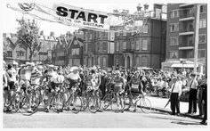 The competitors line up for the start of a stage in the race. That looks to be a Spanish team on the right of the front line. Undated photo, late 1950s - early 1960s?