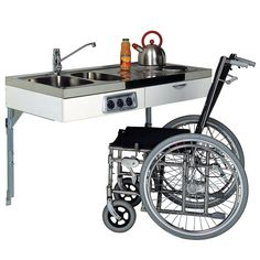 The Famous John Strand Mini Kitchen -- I think this is a really cool idea! Probably not available in the USA, as this is a UK site, but what a great idea for a minimalist kitchen for someone who must function in a wheelchair!