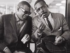"Ray Charles and David Fathead Newman in Amsterdam (at the airport or a hotel?), on May 11, 1963. Photo by Hans Sabel or Henk Daniëls. That night ""[a]t first, the 12,000-strong audience remained seated, listening politely, but Charles soon had everyone on their feet and whipped into such a state of excitement that some tried to clamber up onto the stage. The organisers panicked and got Ray Charles off the stage immediately, thereby ending the show."""