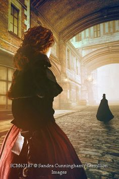 Trevillion Images - victorian-woman-walking-alone-with-cape-figure
