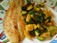 Pan seared white fish with sautéed spinach, zucchini, shaved carrots, and summer squash. Nice, fresh, healthy, and LOTS of flavor. Pan seared the white fish with olive oil and seasoned with Old Bay, sea salt, pepper, and garlic powder on the fish. Sautéed the veggies in olive oil and seasoned with sea salt, pepper, little chili powder, and nutmeg.
