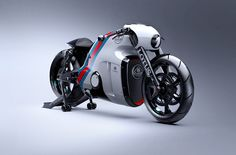 Après deux années de travail, le célébre fabricant de voitures sportives vient de dévoiler sa première moto, la Lotus C-01. Ce design futuriste semble fortement inspiré des véhicules du film Tron.  After two years of work, the famous sports car manufacturer has unveiled his first motorcycle, the Lotus C-01.  This futuristic design seems heavily inspired by the movie Tron vehicles.