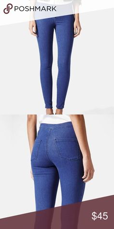 Topshop Moto Joni Jeans 27 Short Matte stretch denim and the super high-waisted silhouette of a pair of medium-blue skinnies let you kick it in effortless throw-back style. Worn once, like new.  27 short. Zip fly with button closure. 68% cotton, 28% polyester, 4% elastane. Topshop Jeans Skinny