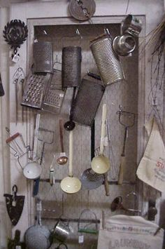 to ] Great to own a Ray-Ban sunglasses as summer gift.vintage kitchenware hanging on hooks an old window covered in chicken wire Old Kitchen, Kitchen Items, Kitchen Gadgets, Vintage Kitchenware, Old Windows, Chicken Wire, Vintage Country, Antique Stores, Window Coverings