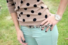 Polka dotted top .Cheetah printed belt and that tinge of mint .Totally a catch.