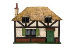 A Tri-ang The Queen's Doll's House, exact replica of the dolls' house furnished by Her Majesty Lead Windows, Dolls House Shop, Play Houses, Doll Houses, Green Front Doors, Her Majesty The Queen, The Saleroom, Sewing Box, Miniature Houses
