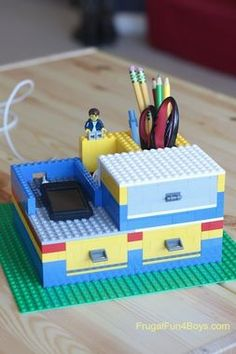 Why waste old LEGOs when you can upcycle?! Check out our awesome LEGO craft projects for kids! This LEGO desk organizer is quirky and cool!
