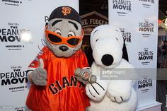 San Francisco Giants mascot Lou Seal and Snoopy arrive at the red carpet premiere of 'The Peanuts Movie' at Pier 39 on October 19, 2015 in San Francisco, California.