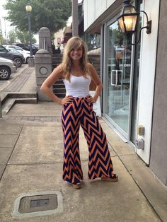 Click the link to order!  http://www.2820boutique.com/#!product/prd1/1074361121/navy-and-orange-chevron-palazzo-pants