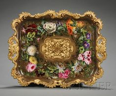 Handpainted Porcelain Tea Tray, England, 19th century, Possibly Painted in a London Workshop that bought blanks ie Thomas Baxter The rectangular form with richly gilded and scrolled rococo-style rim surrounding a powdered brown ground heavily decorated with assorted flowers, lg. 20 5/8 in.