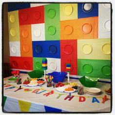 Lego ninjago birthday party!  Lego wall made of plastic table cloths and matching paper plates from dollar tree.