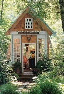 Tiny House in Garden...I love the idea of a playhouse in the garden for my grandchildren.