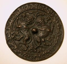"""Bronze mirror, made in Iran in the 13th century. The inscription reads: """"Glory, longevity, power, splendor, honor, praise, beatitude, eminence, sovereignty, increase, might, grace - given to the owner forever""""."""