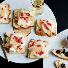Whipped Vanilla Ganache Toasts with Pear and Pomegranate | Whipping a rich and delicious white chocolate ganache makes it light and fluffy. Spread on pain de mie bread toasts, it becomes a delicious dessert.