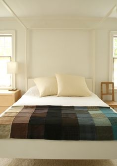 Love this wool patchwork throw. Would be an awesome use of old sweaters!