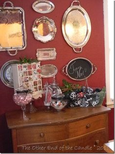 "silver trays arranged over sweet little dresser, adorable at entry way!  Notice one of the trays has been painted with chalkboard paint, ready for your ""welcome"" message!  Sweet!"