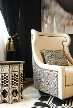#SOFIHomewares - another classic example of the 2 colour-rule.  in this case, black and white.  Luscious, thick black velvet drapery, offset by a cool sleek white leather sofa chair, and there's that moroccan table again! matching the black and white colour theme.