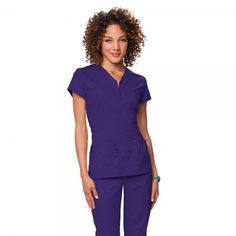 Koi Mackenzie Scrub Top in Grape.  The koi Mackenzie Scrub Top features a stylish top stitched zipper at the front. It is made with superior stretch fabric for a figure-flattering appearance. This form fitting scrub top has front and back darts for shaping. For storage, this women's scrub top has one bungee pocket with toggle on the left, and one right pocket with a small D-ring for ID badge. £29.99   #nursescrubs #dentistuniform #nurses #dentists #purplescrubs