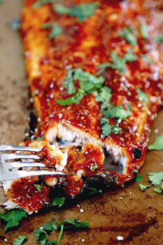 Honey Sriracha Oven Baked Salmon - This is a sweet, spicy and smoky honey sriracha oven baked salmon recipe you won't be able to stop eating - and you only need 10 ingredients and 25 minutes to make it! Easy, Healthy | pickledplum.com