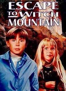 """Escape To Witch Mountain (1975) The 1975 Disney production, Escape From Witch Mountain, is adapted from the Alexander Key novel about a set of psychic twins who desperately want to discover their origins.   Fast-paced, almost to a fault at times, Escape To Witch Mountain relies quite a bit on the """"unspoken"""" communications between the twins, frequently requiring explanations which bog things down. The plot is fairly straightforward, however, and a large, competent cast manages to keep the…"""