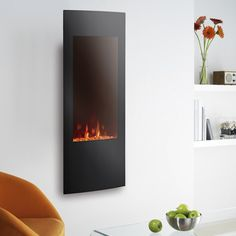 Focal Point Ebony Grand Glass effect Electric Fire. This electric fire features a realistic flame effect which instantly adds an inviting warming glow to the room. This fire has a separate remote control for ease of use. Electric fire by Focal Point Wall Hung Electric Fires, Wall Mount Electric Fireplace, Electric Fireplaces, Modern Fireplaces, Flame Picture, Real Fire, Flat Interior