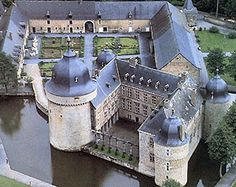 Lavaux-Sainte-Anne Castle Namur, Belgium.  Erected by the Berlo family circa 1450, w/ a defensive moat, round towers, drawbridge, loopholes and a curved dike, forcing to assailants to lay in the open In 1464 the castle was besieged unsuccessfully by the citizens of Dinant. In 1630 it was bought by the baron Jacques-Renard de Rouveroy. Due to the evolution of war tactics, castle defenses became obsolete, so he turned it into a country mansion & took down a curtain wall & added the bulbous…