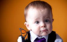butterfly on baby's shoulder