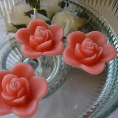 12 Coral Reef floating rose wedding candles for table centerpiece and reception decor.