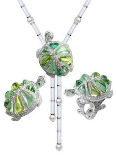 "The ""Galapagos"" jewellery comes in white gold, diamonds, emeralds and tourmalines as well as extraordinarily large peridots, specially created for the model. The line has a ring and a necklace that can be worn as a brooch"