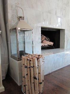 clear cylinder glass vase to hold birch logs {oh, and yeah, that tile is gorgeousness}