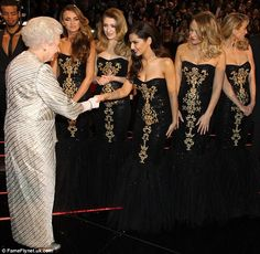 The singer beamed from ear to ear as she and the rest of Girls Aloud met Queen Elizabeth II at Monday night's Royal Variety Performance at London's Royal Albert Hall. Nadine Coyle, Kimberley Walsh, Cheryl Fernandez Versini, English Royal Family, Wax Lyrical, Girls Aloud, Meet Girls, Cheryl Cole, Royal Albert Hall