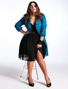 This blue coat and black dress combination could be the start of something interesting....