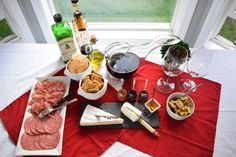Inspiration for a fun date night in – have a wine and cheese picnic at home! Throw a tablecloth down and lay out a delicious spread of cheeses, cured meats, jams, bread, nuts, and of course, …