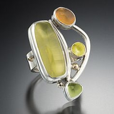 Marilyn Greenwood  	  Mexican fire opal, prehnite and peridot set in silver with gold accents