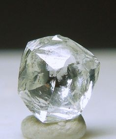 A lively colorless Diamond crystal with complex crystallization.  It has great clarity and lustrous faces. It weighs 0.24 carat