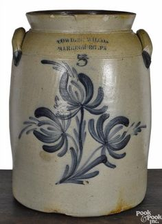 Winning bid:$400  Pennsylvania three-gallon stoneware crock, 19th c., impressed Cowden & Wilcox Harrisburg, PA, with cobalt floral decoration, 13'' h. - Price Estimate: $300 - $500