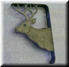 Wall or shelf bracket.  Steel flat bar bent to correct angle, with a plasma cut Small Elk head as the support!