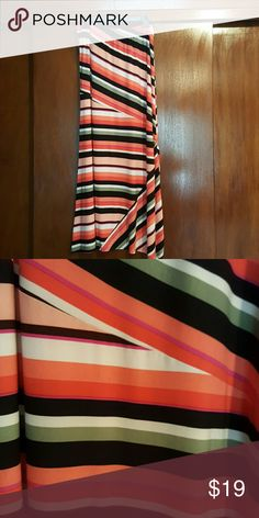 Colorful Maxi Skirt! Maxi Skirt has beautiful, bold colors! Elastic waist. 93% polyester,  7% spandex.  39 inches long. Size medium. Like new!  Perfect for work or play! Skirts Maxi