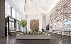 Reading Themes, Sales Center, Sales Office, Lobby Interior, Wall Paint Colors, Real Estate Sales, Green Plants, Design Agency, Terrazzo